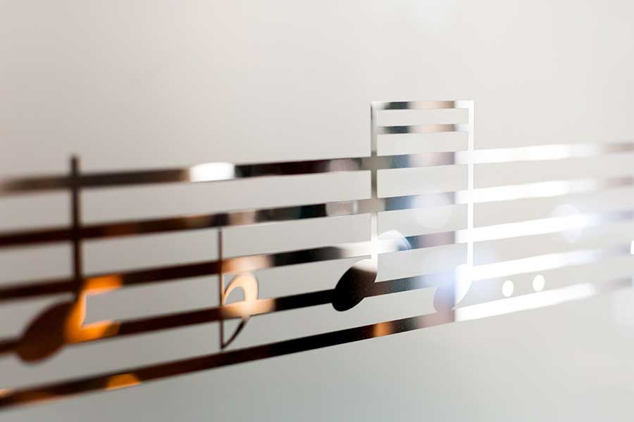 Frosted glass with musical notes design