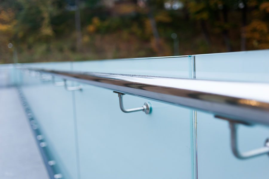 Frosted glass balustrade with floating stainless steel handrail
