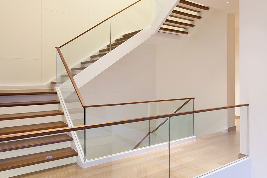 Frameless glass stair balustrade with timber handrail