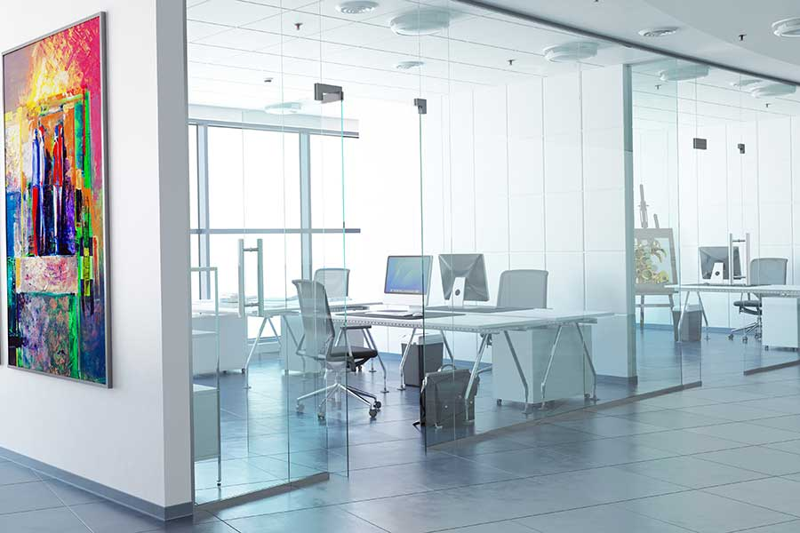 Modern office interior with stylish glass partitions