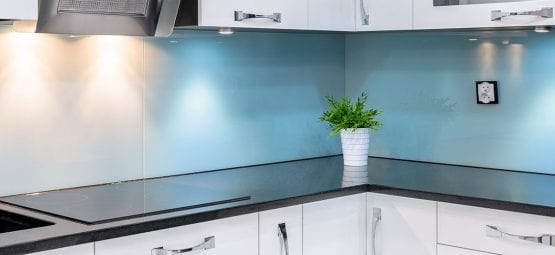 Blue painted glass kitchen splash back