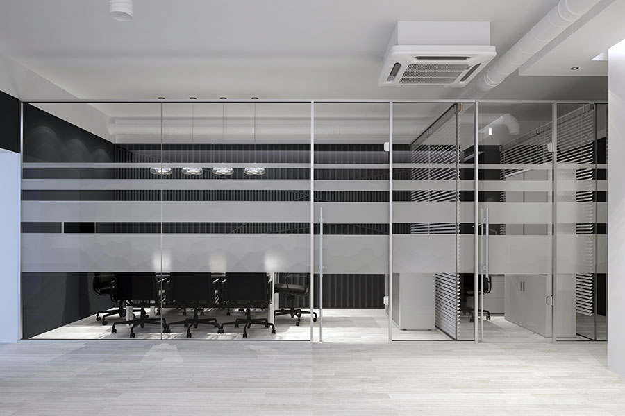 Glass office partition with frosted pattern
