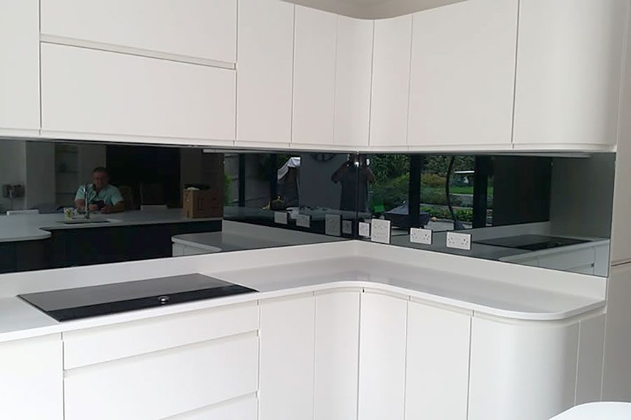 Gloss black painted glass splashback