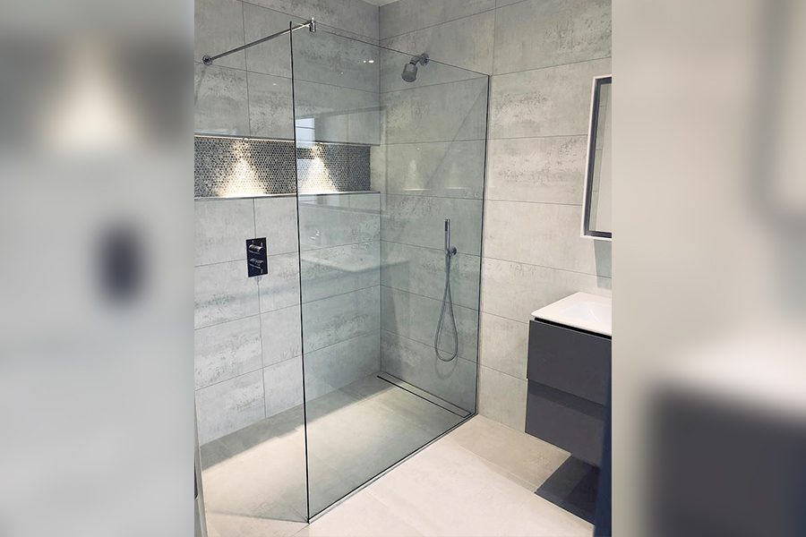 frameless corner shower enclosure with niche