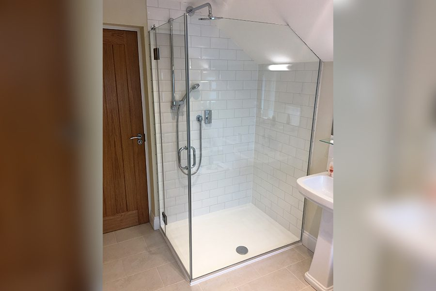 frameless glass shower enclosure with diagonal edge