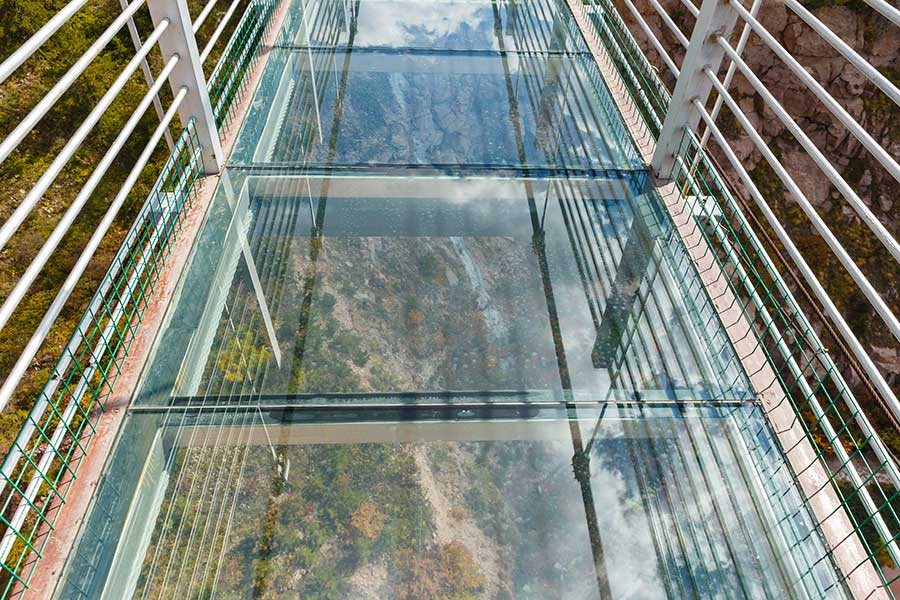 Glass floor on a suspension bridge above a valley