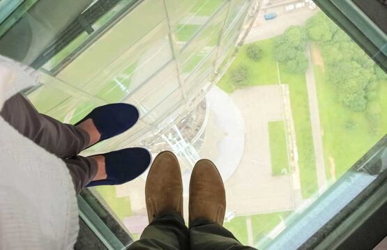 Glass floor panel with view to the ground from a tall building