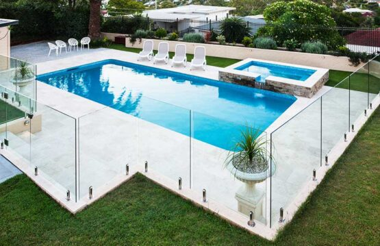 Stunning modern swimming pool with frameless glass pool safety fencing